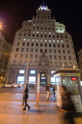 MADRID, SPAIN - CIRCA APRIL, 2014: Nightlife in the streets of downtown Madrid Madrid Adult Architecture Building Exterior Built Structure City City, Illuminated Men Night Outdoors People Real People Sky Women