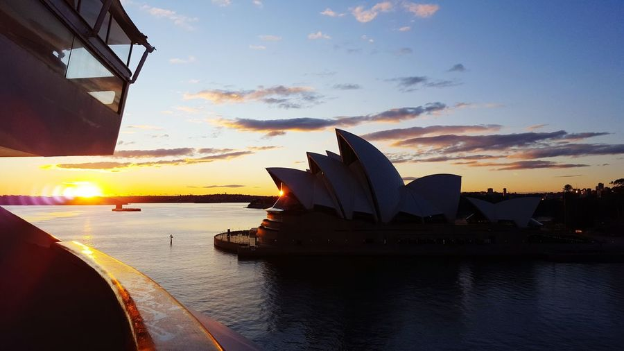 Sydney as the sun comes up & the ship comes in.. Travel Travel Destinations City Harbor Opéra Sea Reflection Vacations Urban Skyline Sky Building Exterior Sunset Architecture Performing Arts Event Cultures