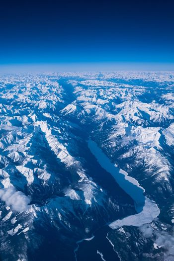 EyeEm Selects Blue Nature Aerial View Beauty In Nature Scenics - Nature Sky No People Tranquil Scene Clear Sky Winter Tranquility Day Environment Idyllic Cold Temperature Snow Landscape Snowcapped Mountain