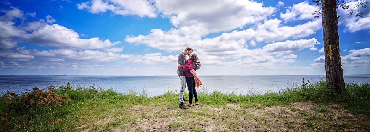 Love is in the air. Sky Cloud - Sky Sea Water Nature Real People Love Kiss Kissing Romance Romantic Beach Beauty In Nature Scenics Wide Angle Outdoors Traveling Travel Photography Baltic Sea Couple Real Love  Romantic Kiss