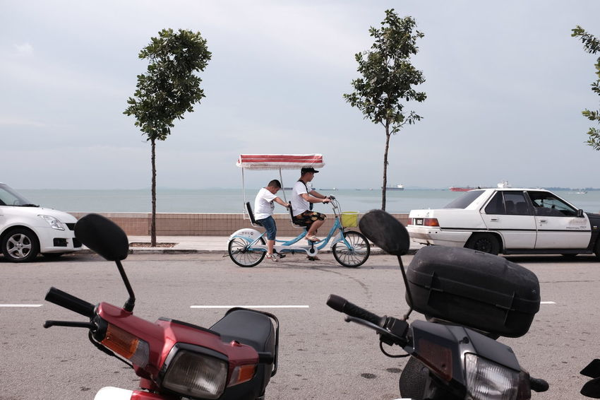 Walking around Fort Cornwallis Park in George Town, Penang, Malaysia. Georgetown Penang Bicycle Land Vehicle Mode Of Transport Nature Outdoors Penang Malaysia Riding Sky Street Photography Streetphotography Transportation Tandem Tandem Bike Bike Connected By Travel