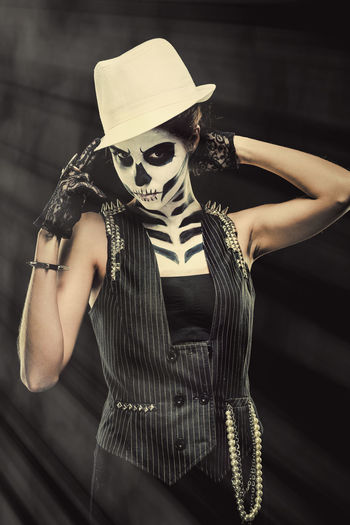 Woman with skeleton face art Black Background Day Of The Dead Halloween Hat Horror Looking At Camera Make-up Makeup Skeleton Woman Body Arts Concept Conceptual Face Art One Person Ring Skull Studio Shot Young Adult