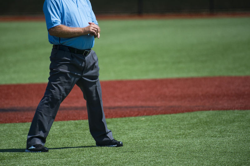 Plate umpire on baseball field, copy space Baseball Referee Athlete Clothing Competition Day Focus On Foreground Grass Green Color Human Leg Leisure Activity Lifestyles Low Section Men One Person Playing Field Real People Sport Sports Uniform Sportsman Standing