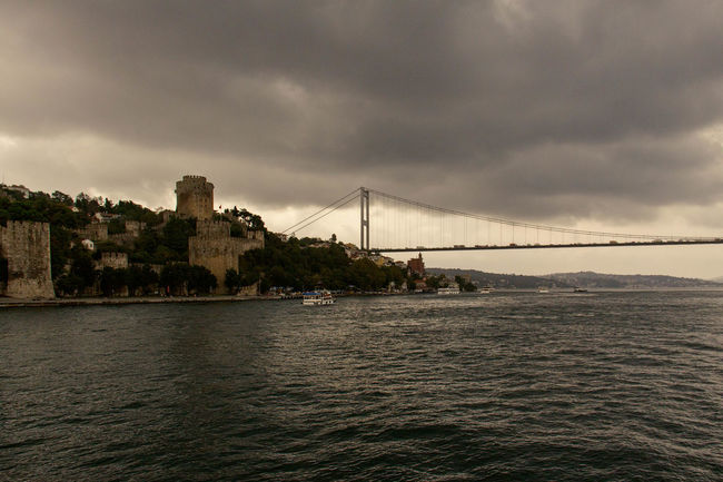 Rumeli Hisari Architecture Bridge Bridge - Man Made Structure Built Structure Castle, Fortress, Protection, Fort, Security, Ancient, Dominating Cloud Cloud - Sky Cloudy Connection Day Fortress, Fort, Stronghold, Fortification, Keep, Citadel Nature Outdoors Overcast Rippled River Rumeli Hisarı Rumelihisari Scenics Sky Tranquil Scene Travel Destinations Turkey, Istanbul, Europe, European, Asia, Asian, Bosphorous, Water, Black Sea, Sea, Water Waterfront
