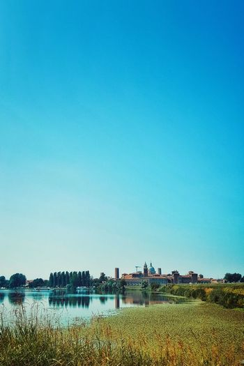 Check This Out Taking Photos Hello World First Eyeem Photo Hanging Out City Day No People Built Structure Low Angle View Sunlight Travel Destinations Architecture Sky Blue EyeEm Gallery Beauty In Nature Lake View Blue Sky Bridge - Man Made Structure Summer in Mantova, Italy