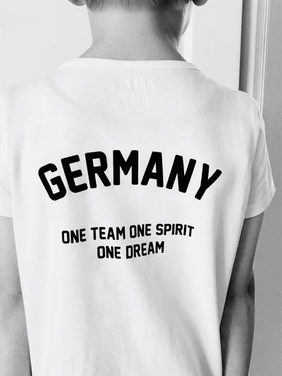 World Cup 2018... Germany🇩🇪 Germany Blackandwhite Black & White Bnw_collection FIFA World Cup Of 2018 World Cup 2018 Text Western Script Communication One Person Casual Clothing Indoors  T-shirt Human Body Part Rear View Midsection Lifestyles Real People Single Word Sign Clothing Capital Letter Message Standing