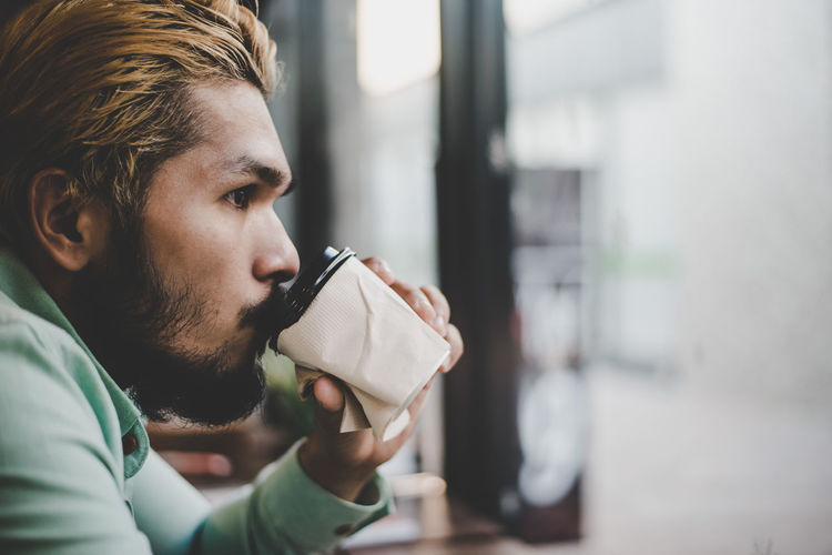 Beard Day Drink Drinking Facial Hair Focus On Foreground Food And Drink Headshot Holding Indoors  Men One Person Portrait Real People Refreshment Side View Young Adult Young Men