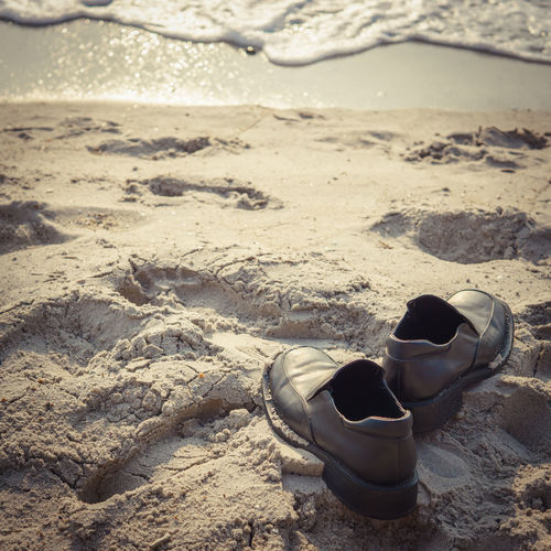 summertime Summertime Absence Beach Beachphotography Day Focus On Foreground Land Nature No People Outdoors Sand Sand Dune Sea Shoe Summer Sunlight Sunrise Tranquility Water