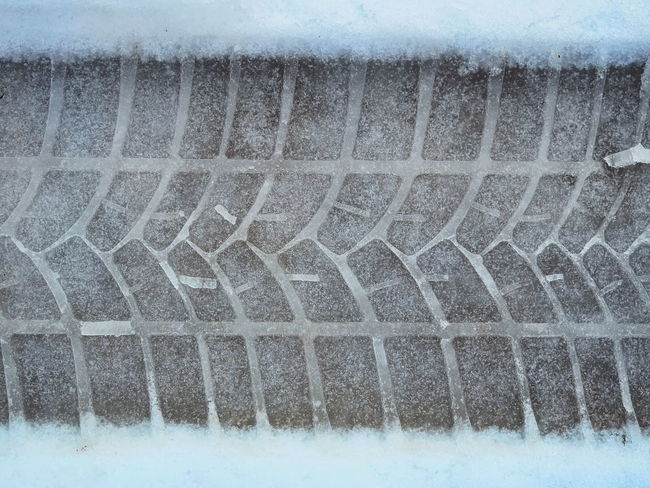 Car tyre print on the snow Snow Winter Cold Temperature No People Close-up Full Frame Nature White Color Day Water Frozen Outdoors Ice Pattern Sport Soap Sud Backgrounds Blizzard Wheel Driving Safety Safety First! Frozen Asphalt Speed Dangerous Insurance