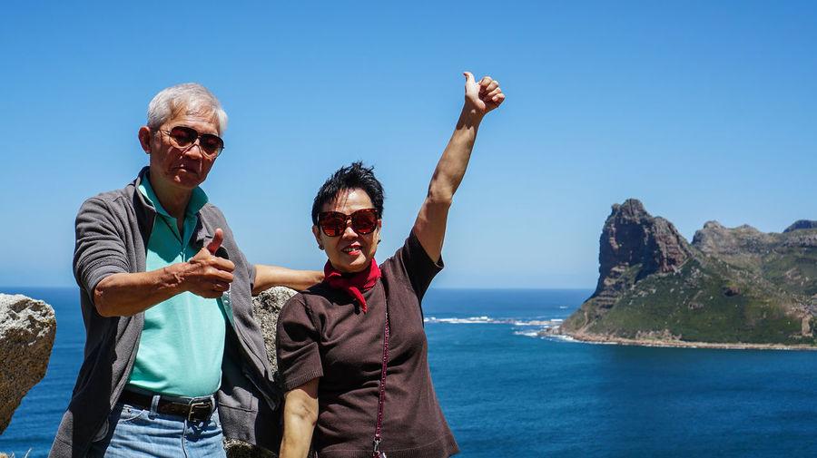 Asian senior couple travel anniversary trip in south africa beautiful  sea and sky beach coastline