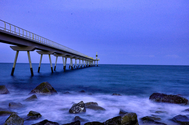 Architectural Column Beach Beauty In Nature Blue Built Structure Clear Sky Horizon Horizon Over Water Long Nature No People Outdoors Power In Nature Rock Rock - Object Scenics - Nature Sea Sky Tranquility Water Wave
