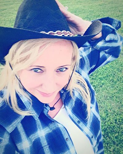Looking At Camera Portrait One Person Leisure Activity Smiling Day Young Adult Childhood High Angle View Real People Happiness Teenager Outdoors Lifestyles Young Women Girls Lying Down Grass Vacations Selfie Texas cowgirl Texas Cowgirl