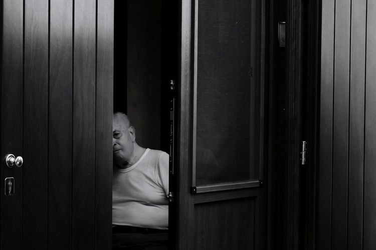 Man seen through half open door
