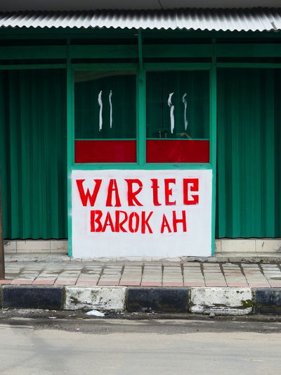 Barokah Foodshop Text Red Communication No People Building Exterior Architecture Bogor City Of Rain Colourful Colour Of Life Somewhere In The World Somewhere Over The Rainbow Make Me Remember You  Somewhere I Remember Let's Take A Walk Miles Away From Seeing You Contrasting Colors Street Photography Small Shop Business And Finance Street Shops Close-up Small Shop Sign Text Colour Splash Colours Of Life