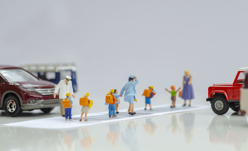 People in toy car on road against sky