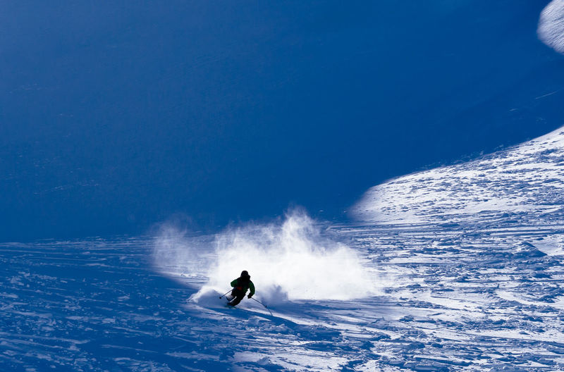 Extreme skiing in Verbier Activity Adventure Blue Cold Temperature Day Extreme Sports Full Length Healthy Lifestyle Leisure Activity Lifestyles Motion Nature One Person Outdoors Real People Ski Holiday Skill  Snow Snowboarding Speed Sport Stunt Vacations Winter Winter Sport