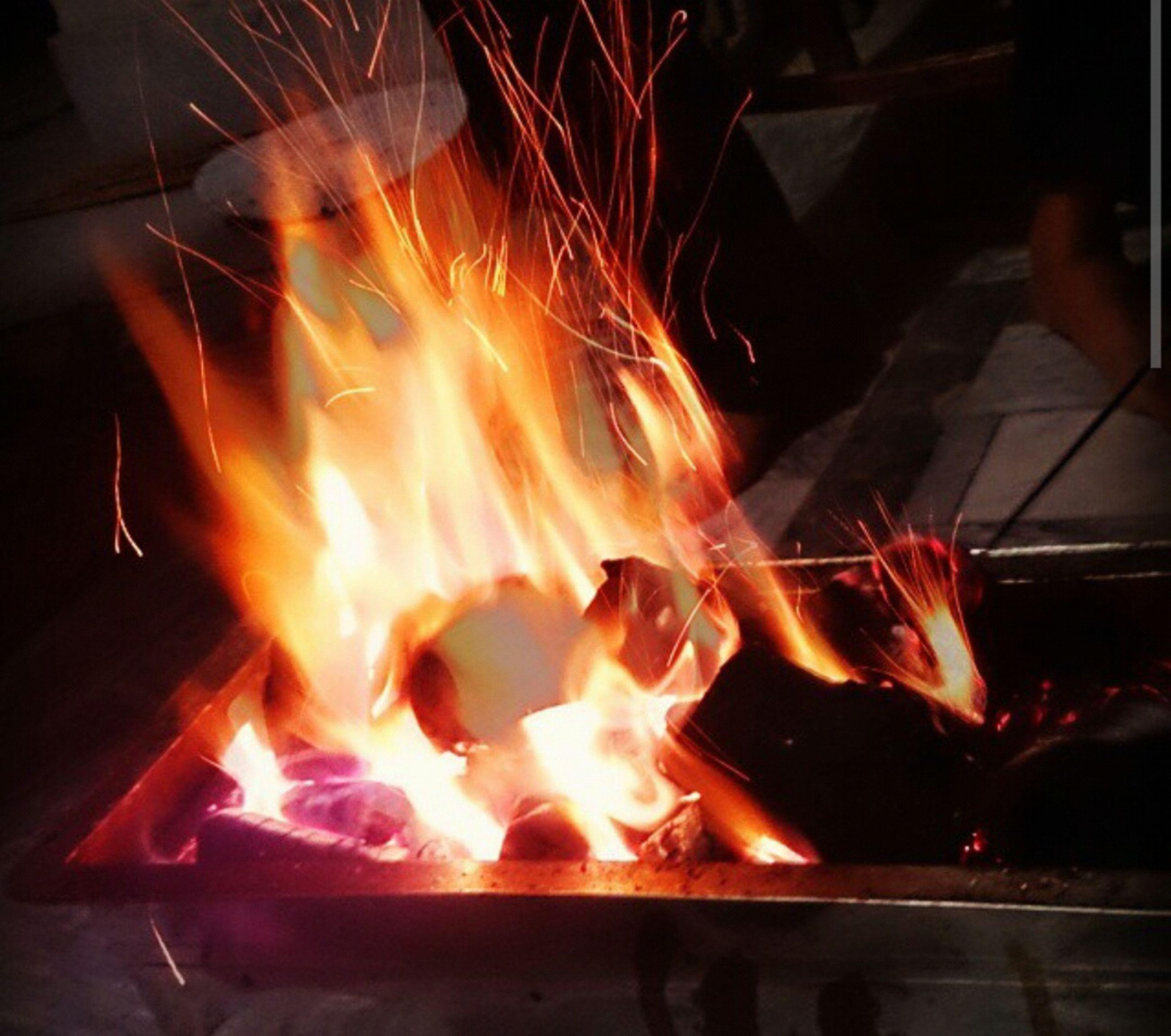 fire - natural phenomenon, flame, burning, night, heat - temperature, illuminated, glowing, motion, bonfire, fire, long exposure, indoors, campfire, light - natural phenomenon, firewood, blurred motion, arts culture and entertainment, celebration, heat, dark