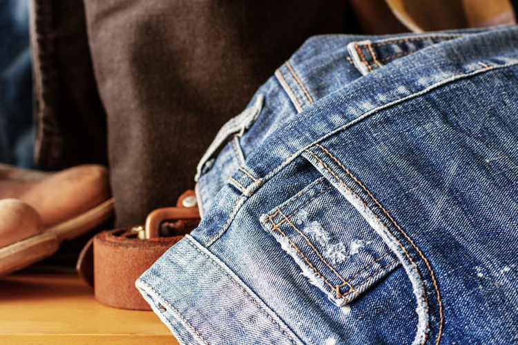 Close-up of jeans on floor