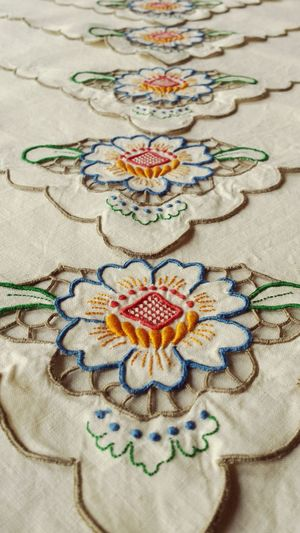 This image looks as if the iron had nothing to do with it! But it did. Pattern Showcase: December Textures And Surfaces Vintage Decor Design Pretty Decor Interior Vintage Detail CutOut Flowers Floral Ecru Ivory Linen Textile Textiles Colourful Embroidered Embroidery Tablecloths Table Tablecloth Ironing