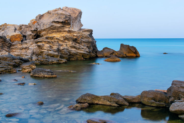 Rocks and exposure without ND filter. Water Reflections Long Exposure Rock Travel Sunset Beach No People Coastal Feature Tunis Tunisia Landscape Water Sea Rock - Object Horizon Over Water Ocean Beach Shore Rock Formation Rocky Coastline Seascape Coast Coastline Calm