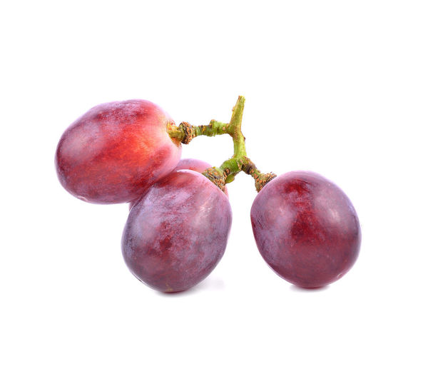 Close-up of cherry against white background