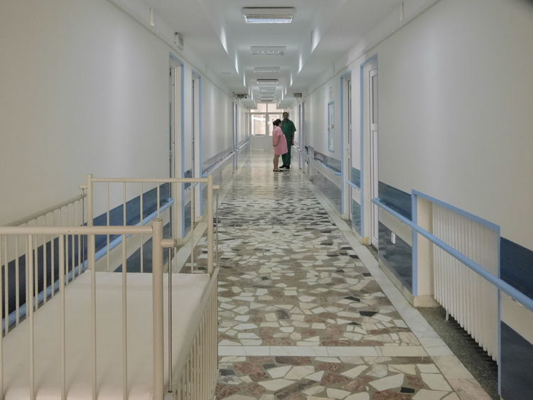 Architecture Day Hallway Hospital Indoors  Interior Man And Woman Mozaïque People Pregnant Woman Symetrical The Way Forward Tiled Floor Two Persons