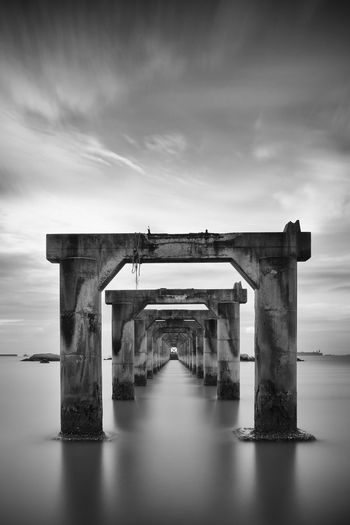 Long exposure shot of an abandoned jetty Abandoned Architectural Column Architecture Beauty In Nature BigStopper Blackandwhite Cloud Cloud - Sky Cloudy Day Diminishing Perspective Fujifilm Fujifilm_xseries Jetty Leefilters Long Exposure Nature No People Outdoors Seven Sky Tranquility Water Weather