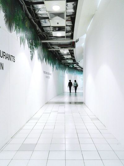 Walking Rear View Built Structure Architecture Indoors  Adult Men People Adults Only Only Men Day Tow People Two People Full Length Women City
