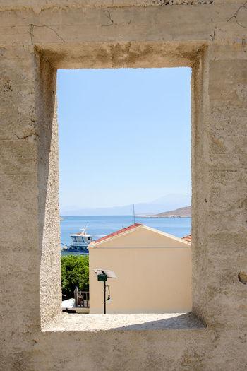 Framed - Halki, Greece, 2018 Aegean Sea Framed Architecture Beach Building Building Exterior Built Structure Greece Horizon Over Water Nature Scenics - Nature Streetphotography Sunlight Window