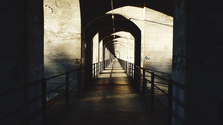 Narrow footbridge along pillars in row