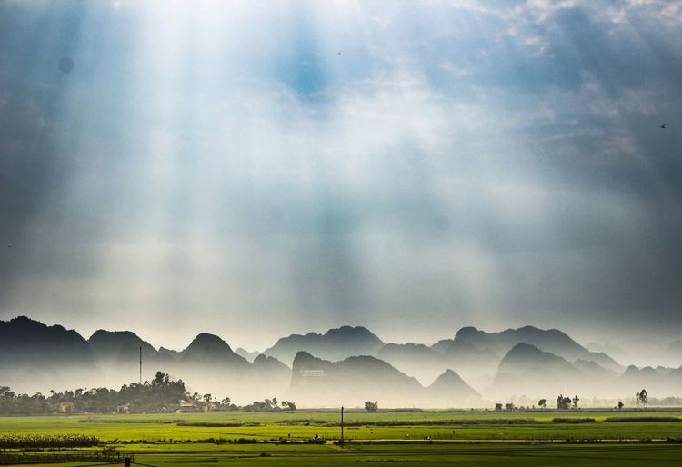 What a magical place on earth to live ! Sunbeams Through The Clouds Phongnha Limestonemountains EyeEm Selects Agriculture Farm Cloud - Sky Sky Field Nature Mountain Landscape