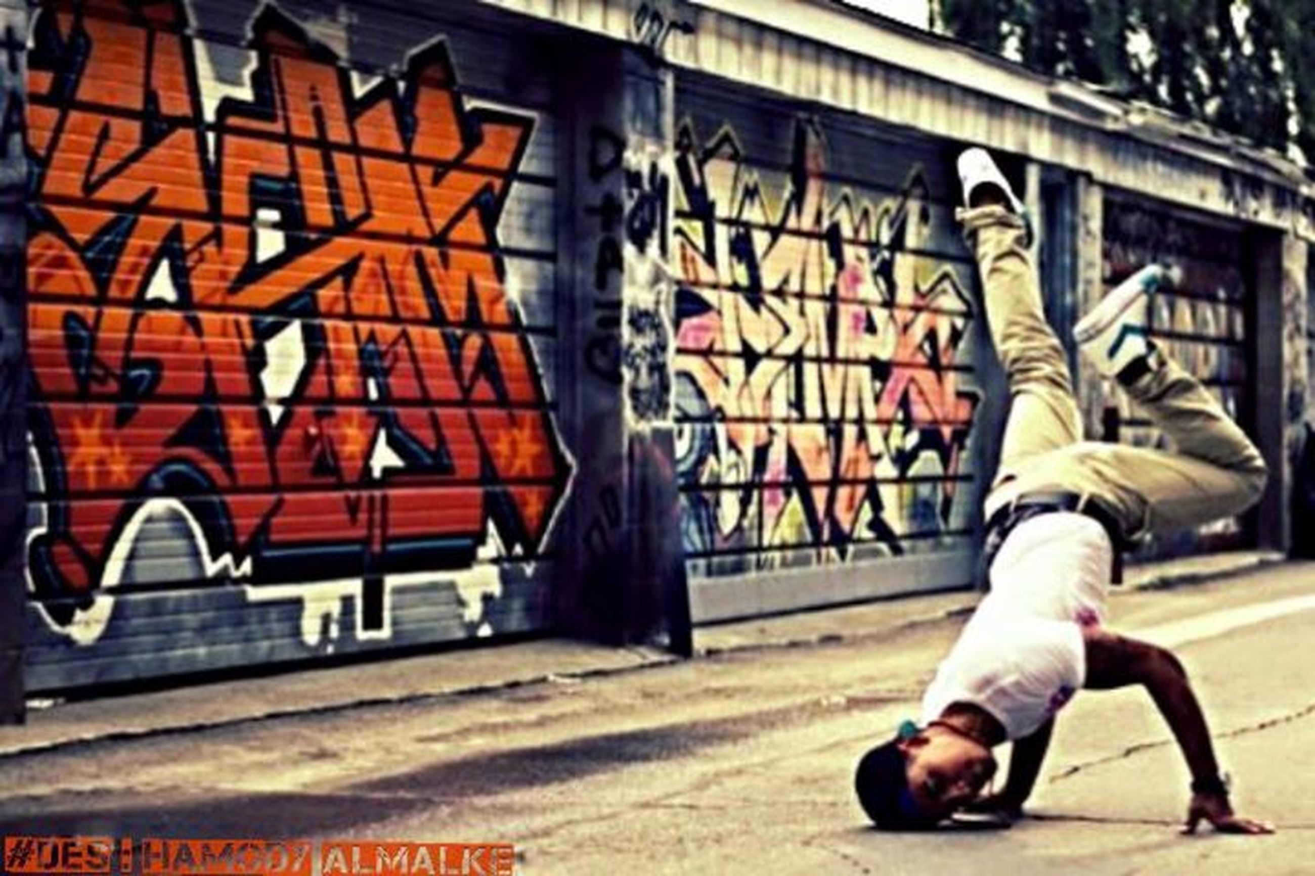 graffiti, architecture, building exterior, built structure, art, art and craft, creativity, wall - building feature, text, street art, animal representation, human representation, outdoors, mural, day, animal themes, building, vandalism, no people, wall
