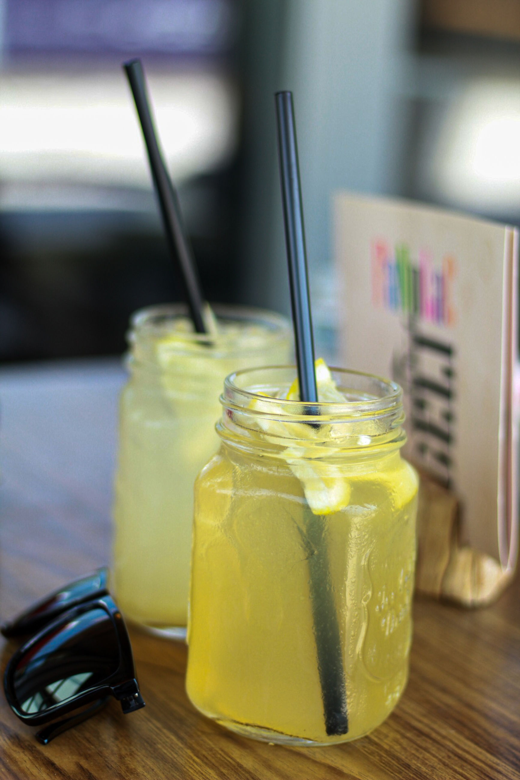 food and drink, food, jar, drink, refreshment, straw, freshness, table, fruit, healthy eating, drinking straw, still life, focus on foreground, indoors, close-up, container, wellbeing, yellow, glass, technology, no people, temptation