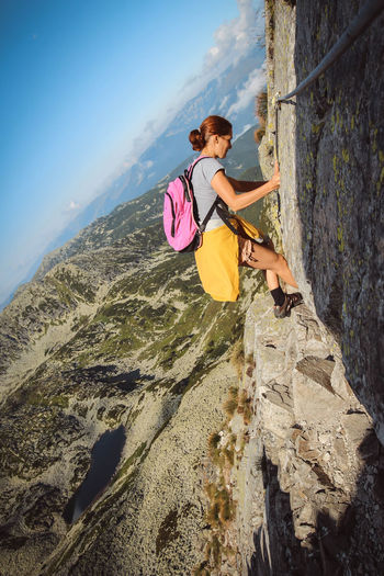Retezat mountains Adventure Beauty In Nature Climbing Day Extreme Sports Full Length Leisure Activity Lifestyles Mountain Nature One Person Outdoors People Real People Rear View Rock - Object Rock Climbing Scenics Sky Sports Clothing Young Adult Young Women Go Higher