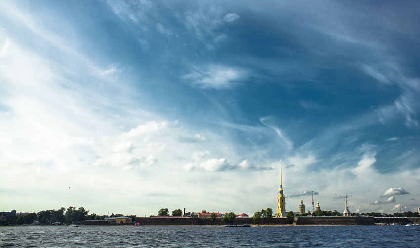 Saints peter and paul cathedral and river against sky in city