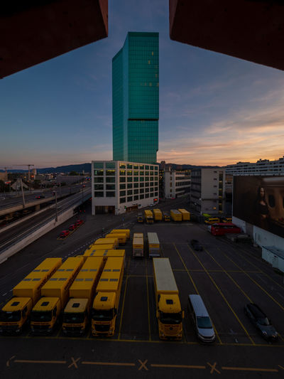 High angle view of road amidst buildings against sky during sunset