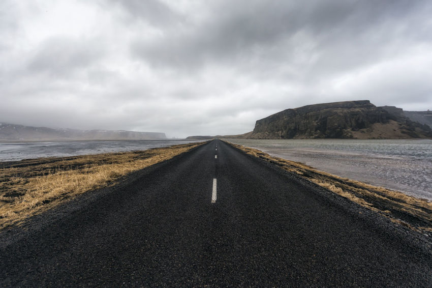 Landscape in Iceland Beauty In Nature Cloud Cloud - Sky Cloudy Day Diminishing Perspective Empty Empty Road Landscape Long Mountain Nature No People Non-urban Scene Outdoors Overcast Road Scenics Sky The Way Forward Tranquil Scene Tranquility Vanishing Point Water Weather