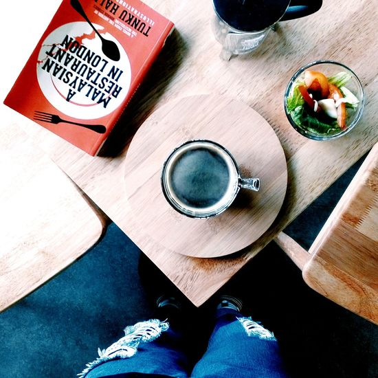 Directly Above Shot Of Black Coffee And Salad On Table