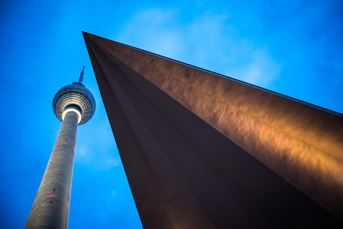 Architecture Blue Building Exterior Built Structure City Cloud - Sky Connection Day Low Angle View Modern No People Outdoors Sky Skyscraper Tall - High Tower Travel Destinations Discover Berlin