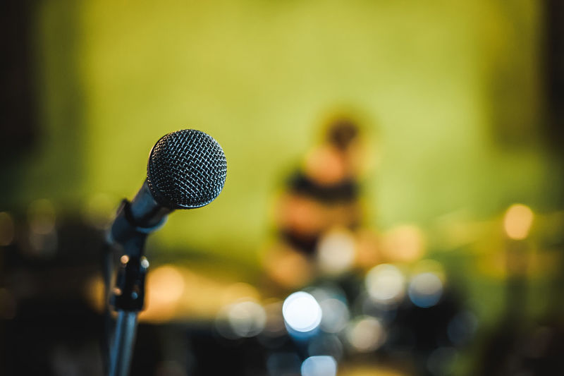 Close-Up Of Microphone Against Defocused Lights