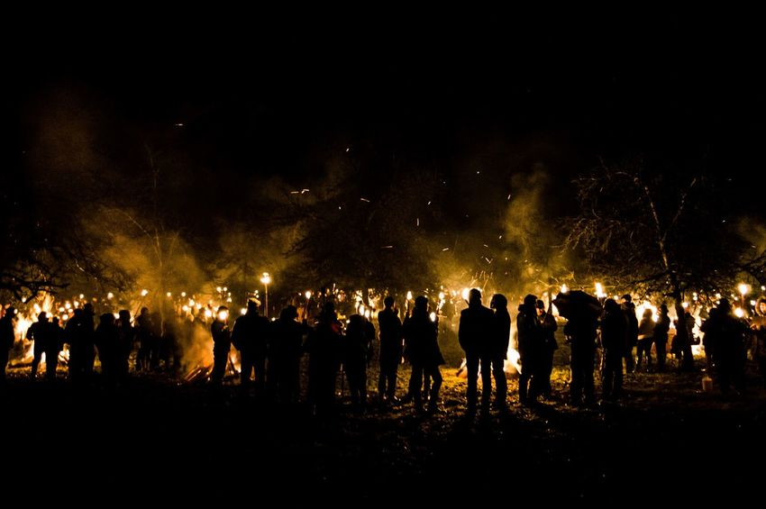 Eardisley, Herefordshire, UK. 6/7/2017. Members of the Leominster Morris folk dance group take part in a Mummers Play and torch lit Wassailing ceremony on the Epiphany, also widely known as Three Kings Day, or even Dia de los Tres Reyes Magos. The Christian holiday is typically celebrated 12 days after the Christmas in the Gregorian calendar, and serves, traditionally, to commemorate the baptism of Jesus. The holiday was also associated with the three kings' visit to the Christ child. Epiphany is used to describe the final day of the 12-day Christmas celebrations, as well as the season of Epiphany. Epiphany is celebrated globally within the Roman Catholic, Protestant and Eastern Orthodox faiths. Countries, from Mexico and Switzerland to Germany and Spain, observe the religious holiday. Arts Culture And Entertainment Audience Celebration Crowd Eardisley Epiphany Herefordshire Illuminated Large Group Of People Night Outdoors People Real People Silhouette Twelfth Night Wassail