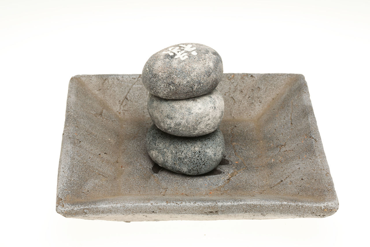 stack, white background, stone material, no people, balance, pebble, studio shot, sculpture, close-up, mass - unit of measurement, day