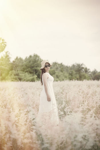 Busy Young Adult Wedding Adult Standing Bride One Person Newlywed Women Event Full Length Plant Fashion Celebration Wedding Dress Dress Nature Land Beautiful Woman Outdoors Contemplation