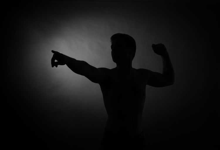 Rear view of silhouette man against gray background
