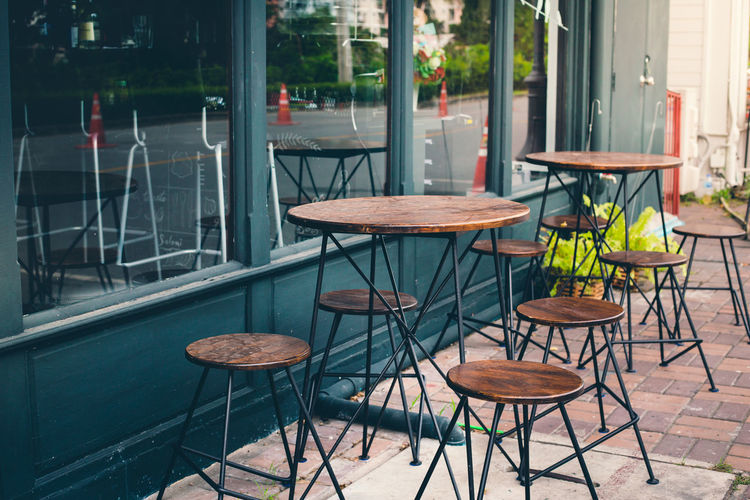 Selective focus of empty table and chair of cafe outside view with vintage color tone Dinner Cafe Drink Eat Europe Food Hangout Party Restaurant Seat Shop Sky Vintage