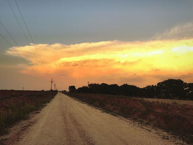 """""""Once Upon a Road in West Texas"""" A sunset bathed bank of clouds gathers over the cotton fields of West Texas viewed along a lonely country backroad. Sunset The Way Forward Sky Road Landscape Scenics Field Cloud - Sky Countryroads Dirt Road Silhouette Westtexas Westtexasskies Texas Texas Skies Cottonfields Clouds Clouds And Sky Cloudscape"""