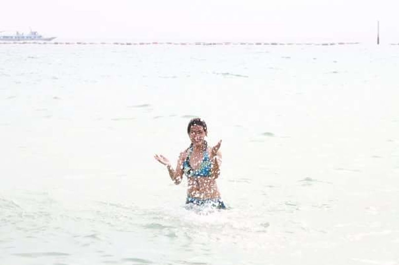 water, motion, splashing, fun, sea, one person, young adult, beach, outdoors, happiness, wet, day, nature, wave, only women, young women, beautiful woman, horizon over water, one young woman only, one woman only, beauty in nature, adult, sky, adults only, people