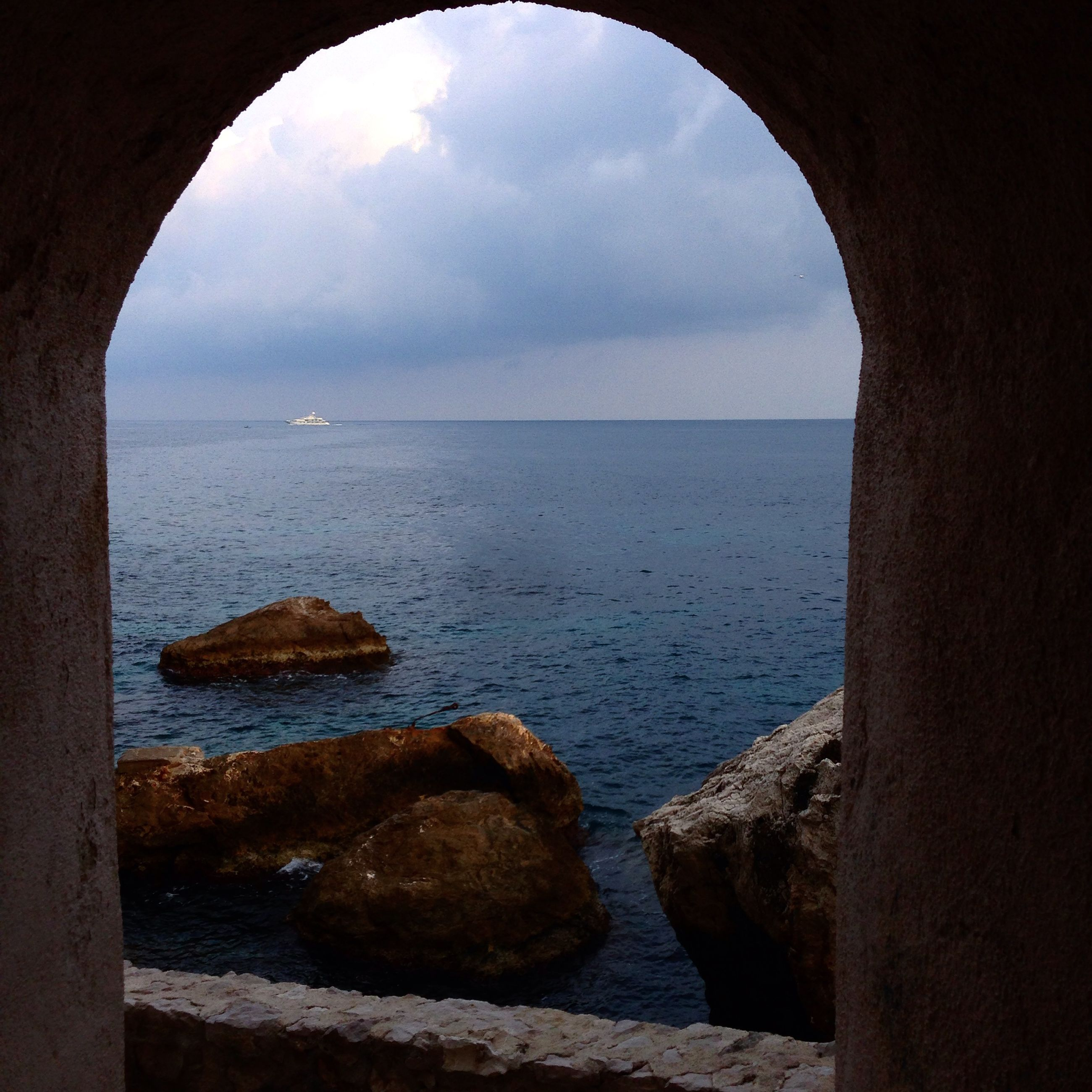 sea, sky, horizon over water, water, arch, indoors, tranquility, cloud - sky, scenics, tranquil scene, built structure, beauty in nature, nature, cloud, architecture, beach, rock - object, idyllic, day, cloudy