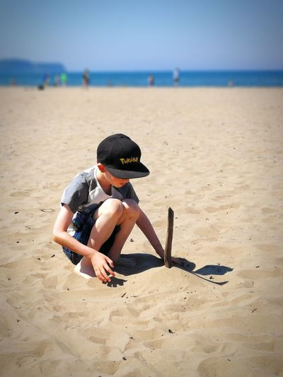 EyeEm Selects Sand Pail And Shovel Child Sea Beach Sitting Full Length Sand Boys Childhood Summer Horizon Over Water Calm