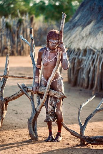 Hamerwoman Hamer Tribe Omo Valley Ethiopian Ethiopian Photography 🇪🇹 Portrait Of A Woman Tribal Portrait Photography African Travel Destinations Ethiopia Nature Real People Full Length Sunlight Land Day Men Lifestyles People Outdoors Standing Sand Holding Focus On Foreground Desert Leisure Activity Front View Archival